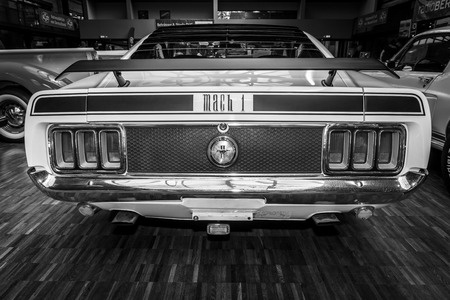 BERLIN, GERMANY - MAY 17, 2014: Ford Mustang Mach 1, 428 cu in (7.0 L) Ramair Cobra Jet - is an performance-oriented option package of the Ford Mustang. Black and white. Rear view. 27th Oldtimer Day Berlin - Brandenburg