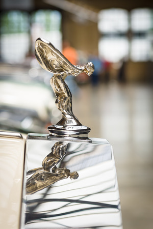 BERLIN, GERMANY - MAY 17, 2014: The famous emblem Spirit of Ecstasy on the Rolls-Royce Corniche IV. 27th Oldtimer Day Berlin - Brandenburg