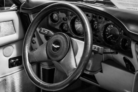 BERLIN, GERMANY - MAY 17, 2014: Interior of the drivers seat of the car Aston Martin V8 Volante. Black and white. 27th Oldtimer Day Berlin - Brandenburg