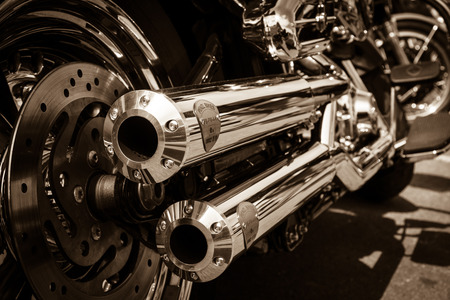 harley davidson motorcycle: BERLIN, GERMANY - MAY 17, 2014: Exhausts of motorcycle Harley Davidson Softail. Rear view. Sepia. 27th Oldtimer Day Berlin - Brandenburg