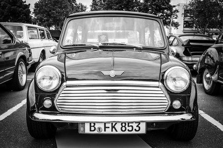 BERLIN, GERMANY - MAY 17, 2014: Small economy car Austin Mini Cooper. Black and white. 27th Oldtimer Day Berlin - Brandenburg