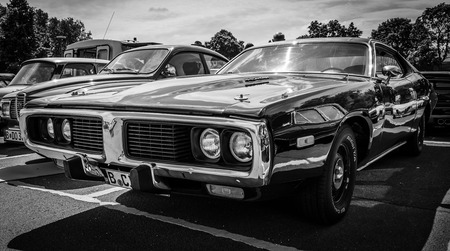 brandenburg: BERLIN, GERMANY - MAY 17, 2014: Mid-size car Dodge Charger (Third generation) with engine 440 Magnum. Black and white. 27th Oldtimer Day Berlin - Brandenburg