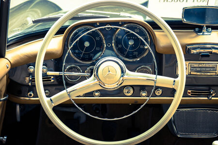 BERLIN, GERMANY - MAY 17, 2014: Interior of the drivers seat of the car Mercedes-Benz 190 SL. Toning, imitation cross-process. 27th Oldtimer Day Berlin - Brandenburg