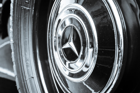 BERLIN, GERMANY - MAY 17, 2014: Wheel (cap) of the luxury car Mercedes-Benz Typ 290 (W18), 1933. Close up. Black and white. 27th Oldtimer Day Berlin - Brandenburg