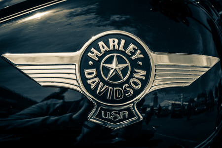 BERLIN, GERMANY - MAY 17, 2014: The emblem on the fuel tank of motorcycle Harley Davidson Softail. Toning. 27th Oldtimer Day Berlin - Brandenburg