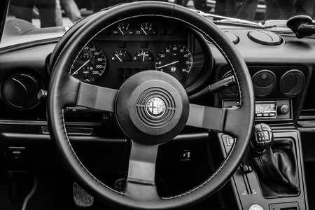 third wheel: BERLIN, GERMANY - MAY 17, 2014: Cab of the roadster Alfa Romeo Spider (Third generation). Black and white. 27th Oldtimer Day Berlin - Brandenburg