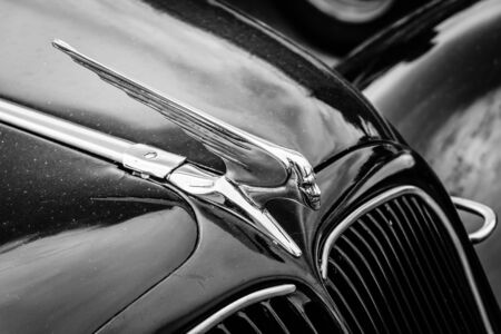 avant: BERLIN, GERMANY - MAY 17, 2014: Hood ornament of the mid-size luxury car Citroen Traction Avant. Black and white. 27th Oldtimer Day Berlin - Brandenburg  Editorial