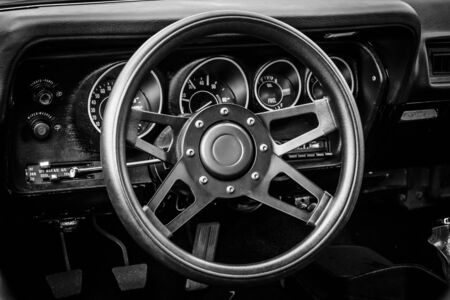 third wheel: BERLIN, GERMANY - MAY 17, 2014: Cab of the mid-size car Plymouth Satellite (Third Generation). Black and white. 27th Oldtimer Day Berlin - Brandenburg Editorial