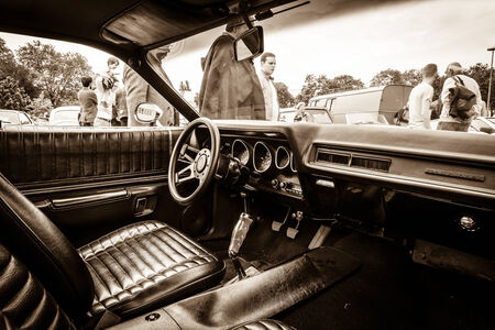 third wheel: BERLIN, GERMANY - MAY 17, 2014: Cab of the mid-size car Plymouth Satellite (Third Generation). Sepia. 27th Oldtimer Day Berlin - Brandenburg