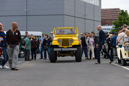 sport utility vehicle: BERLIN, GERMANY - MAY 17, 2014: A compact four-wheel drive off-road and sport utility vehicle (SUV), Jeep Wrangler. 27th Oldtimer Day Berlin - Brandenburg