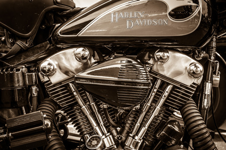 BERLIN, GERMANY - MAY 17, 2014: Twin Cam engine of the motorcycle Harley-Davidson. Sepia. 27th Oldtimer Day Berlin - Brandenburg