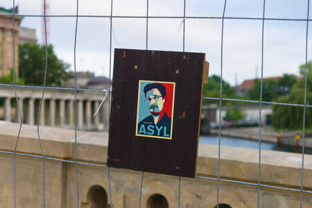 BERLIN, GERMANY - JUNE 06, 2014: Stylized portrait of Edward Snowden on the fence. Former officer of the CIA and NSA.