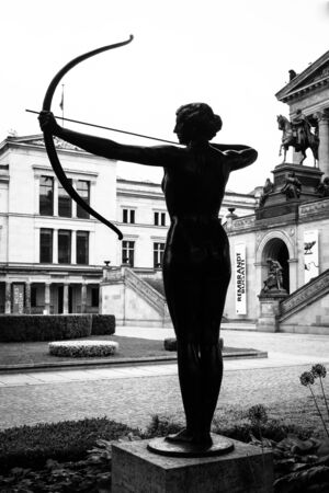 alte: BERLIN, GERMANY - JUNE 06, 2014: A bronze sculpture in front of Alte Nationalgalerie (Old National Gallery). Forest nymph nock an arrow. Black and white.  Editorial