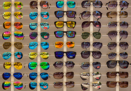 ALANYA, TURKEY - JUNE 28, 2014: Sunglasses Ray-Ban. Background. Ray-Ban is a internationally well-known brand of sunglasses and eyeglasses founded in 1937.