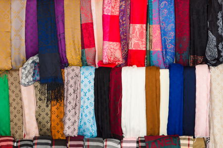 vuitton: ALANYA, TURKEY - JUNE 28, 2014: Cravats and Scarves Louis Vuitton. Background. Louis Vuitton is a French fashion house founded in 1854 by Louis Vuitton