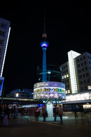 BERLIN, GERMANY - OCTOBER 10, 2014: The Weltzeituhr (Worldtime Clock) at Alexanderplatz and Berlin TV Tower in the night illumination. The annual Festival of Lights 2014
