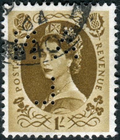 wilding: UNITED KINGDOM - CIRCA 1953: Postage stamp printed in England (Perfin), shows a portrait of Queen Elizabeth II, circa 1953