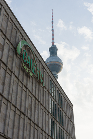 ag: BERLIN - OCTOBER 31, 2014: Galeria Kaufhof at Alexanderplatz. In the background Berlin TV Tower. GALERIA Kaufhof GmbH - the largest retail store Metro AG Editorial