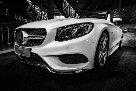 newest: BERLIN - JULY 18, 2014: Showroom. Mercedes-Benz S 500 Coupe (C217). The newest luxury car (since 2014). Black and white. Editorial