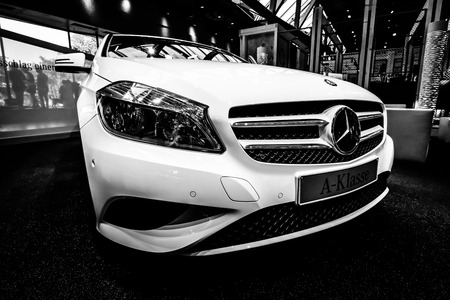 BERLIN - JULY 18, 2014: Showroom. Mercedes-Benz A 200 Urban (W176). The latest top-class car (since 2014). Black and white.