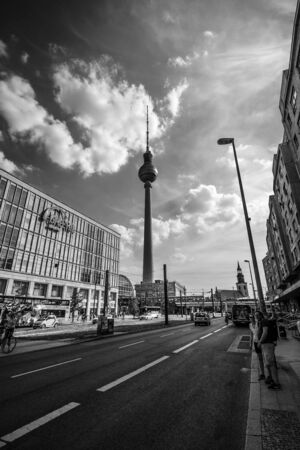 ag: BERLIN - JULY 18, 2014: City landscape. Galeria Kaufhof at Alexanderplatz and Berlin TV Tower. GALERIA Kaufhof GmbH - the largest retail store Metro AG. Black and white.
