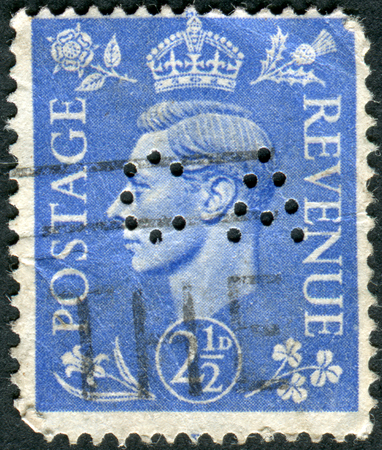 dominions: UNITED KINGDOM - CIRCA 1937: Postage stamp printed in England (Perfin CA), shows King of the United Kingdom and the Dominions of the British Commonwealth, George VI, circa 1937