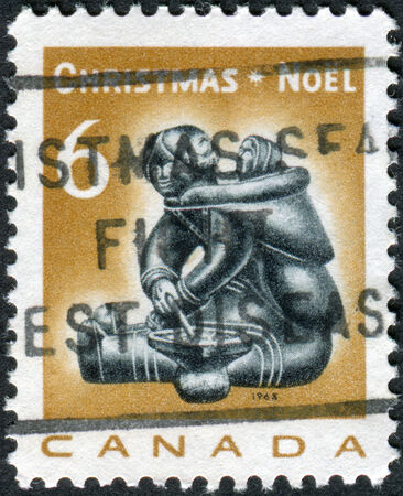 soapstone: CANADA - CIRCA 1968: Postage stamp printed in Canada, Christmas Issue, shows Eskimo soapstone carving: Mother and infant, by Munamee of Cape Dorset, circa 1968