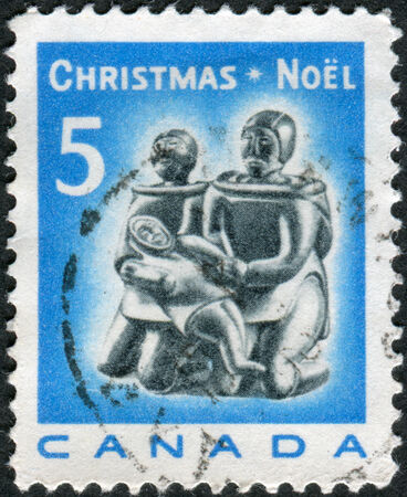 soapstone: CANADA - CIRCA 1968: Postage stamp printed in Canada, Christmas Issue, shows Eskimo soapstone carving: Eskimo Family, circa 1968 Editorial