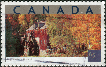 canada stamp: CANADA - CIRCA 2002: Postage stamp printed in Canada shows Tourist Attractions - Kings Landing, New Brunswick, circa 2002