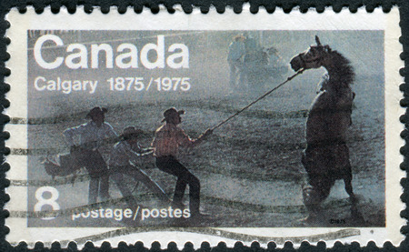 CANADA - CIRCA 1975: Postage stamp printed in Canada, dedicated to Centenary of the founding of Calgary, shows the Untamed (Wild Horse Race), circa 1975