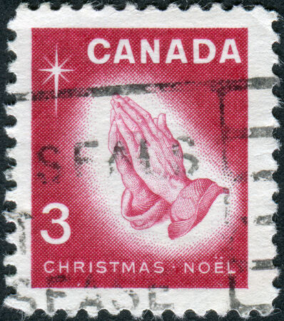 canada stamp: CANADA - CIRCA 1966: Postage stamp printed in Canada, Christmas issue, shows Praying Hands by Albrecht Duerer, circa 1966