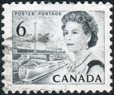 means of transportation: CANADA - CIRCA 1970: Postage stamp printed in Canada, shows Transportation Means, a portrait of Queen Elizabeth II, circa 1970