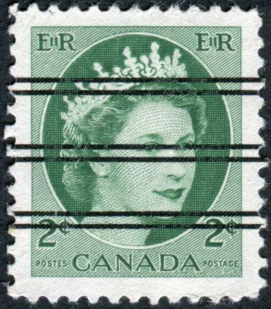 overprint: CANADA - CIRCA 1954: Postage stamp printed in Canada (overprint), shows portrait of Queen Elizabeth II, circa 1954 Editorial