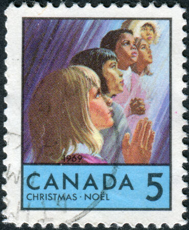 CANADA - CIRCA 1969: Postage stamp printed in Canada, Christmas issue, shows Children of Various races, circa 1969
