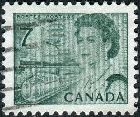 means of transportation: CANADA - CIRCA 1971: Postage stamp printed in Canada, shows Transportation Means, a portrait of Queen Elizabeth II, circa 1971