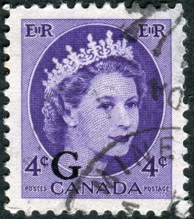 overprint: CANADA - CIRCA 1954: Postage stamp printed in Canada (overprint G, 1956), shows portrait of Queen Elizabeth II, circa 1954