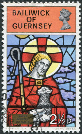 good shepherd: GUERNSEY - CIRCA 1973: A stamp printed in the Bailiwick of Guernsey, shows the Good Shepherd, St. Michel du Valle, circa 1973