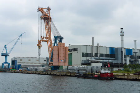 mining ship: ROSTOCK, GERMANY - AUGUST 02, 2014: Warehouse of Caterpillar Inc, in the port of Rostock. Caterpillar is the worlds leading manufacturer of construction and mining equipment.