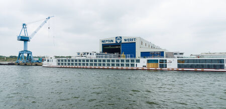 neptun: ROSTOCK, GERMANY - AUGUST 02, 2014: Neptun Werft is a German shipbuilding company, headquartered in Rostock. Rostock is Germanys largest Baltic port