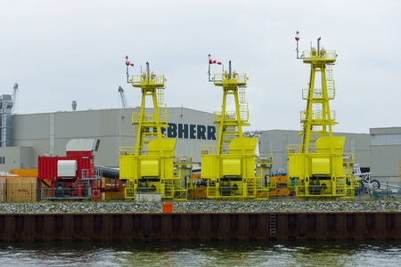 heavy equipment operator: ROSTOCK, GERMANY - AUGUST 02, 2014: The companys warehouse Liebherr, in the port of Rostock. The Liebherr Group is a large German equipment manufacturer specializing in cranes, aircraft parts, and mining.