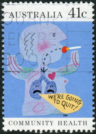 community health: AUSTRALIA - CIRCA 1990: Postage stamp printed in Australia, Community health, shows a childs drawing, Quit smoking, circa 1990
