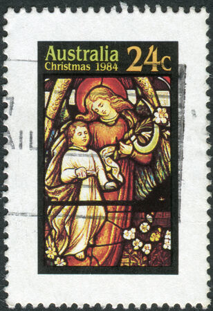 australia stamp: AUSTRALIA - CIRCA 1984: Postage stamp printed in Australia, Christmas Issue, shows Stained glass windows, Angel and Child, circa 1984 Editorial