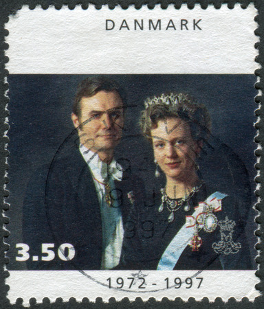 prince of denmark: DENMARK - CIRCA 1997: Postage stamp printed in Denmark, dedicated to the 25th anniversary of coronation Queen Margrethe II, shows Queen Margrethe II with Prince Henrik, circa 1997