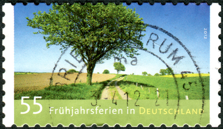 GERMANY - CIRCA 2012: Postage stamps printed in Germany, dedicated to spring break, is a landscape by Andreas Kitting, circa 2012