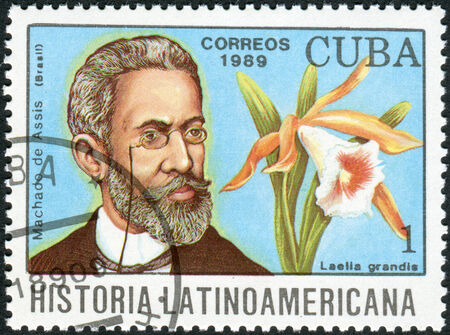 CUBA - CIRCA 1989: Postage stamp printed in Cuba, shows the Brazilian writer Joaquim Maria Machado de Assis and orchid Laelia grandis, circa 1989
