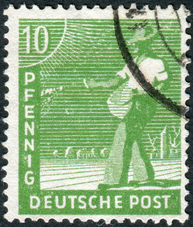 postwar: GERMANY - CIRCA 1948: Postage stamp printed in Germany, shows the sower, circa 1948