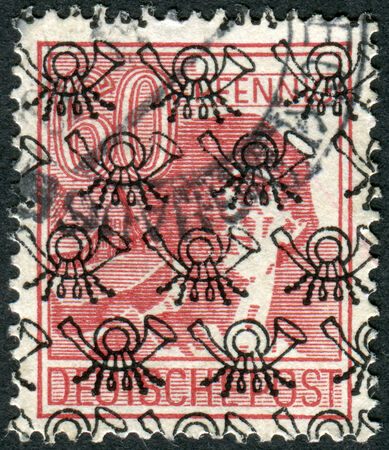 obliteration: GERMANY - CIRCA 1947: Postage stamp printed in Germany (overpint Type B: US and British occupation zone), shows the laborer, circa 1947