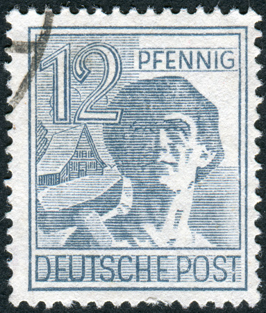 obliteration: GERMANY - CIRCA 1947: Postage stamp printed in Germany, shows the laborer, circa 1947
