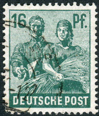 postwar: GERMANY - CIRCA 1947: Postage stamp printed in Germany, shows Reaping Wheat, circa 1947 Editorial