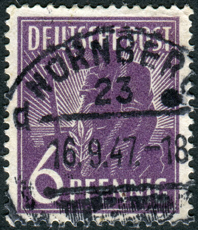 postwar: GERMANY - CIRCA 1947: Postage stamp printed in Germany, shows Planting Olive, circa 1947 Editorial